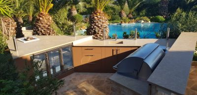 Outdoor Kitchen by a pool